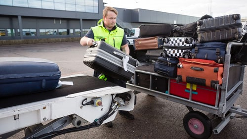 Baggage Handlers Loading Passenger Luggage Airplane Ramp