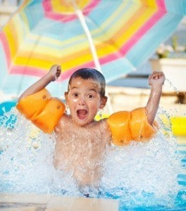 boy in swimming pool 264x300 Swimming Pool Drowning & Accidents