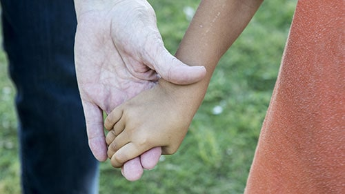 Child Holding Hands Foster Care Parent