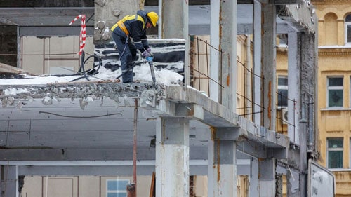 Construction Worker on Commercial Property Using Jackhammer