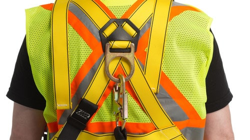 Construction Worker Wearing PPE (Personal Protective Equipment) Fall Arrest Gear