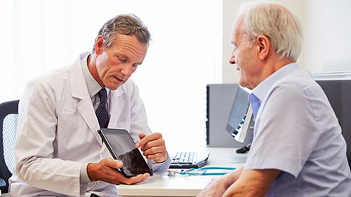 Elderly Male Patient Meeting With Physician