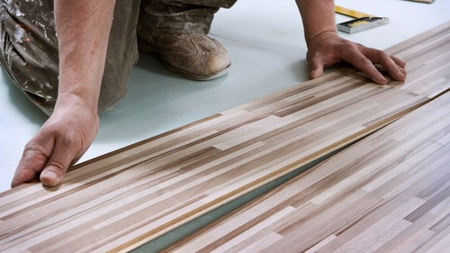 Flooring Installer Making New Material Home Improvement