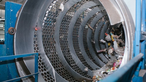 Recycling Plant Workers By Conveyor Belt Separating Recycled Materials