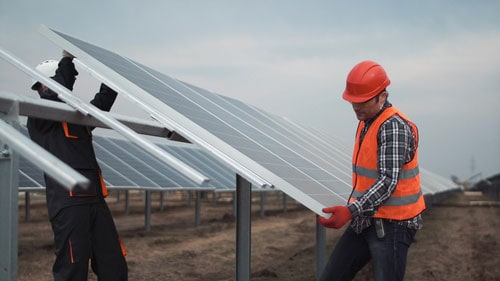 Solar PV Workers Install Solar Farm Panels