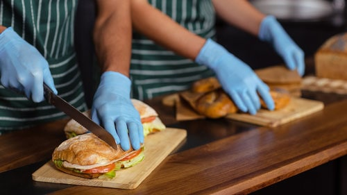 Subway Sandwich Workers Behind Counter Making Specialty Sandwiches