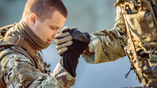 United States Soldiers Helping Each Other