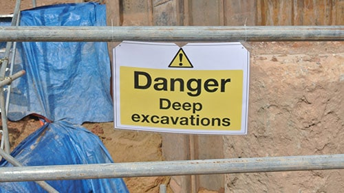 Danger Sign Posted to Avoid Construction Site Accidents in Excavated Areas
